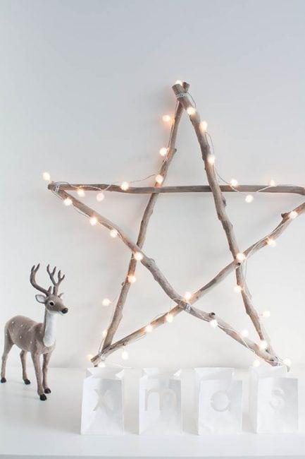 decorar con ramas de árboles - estrella